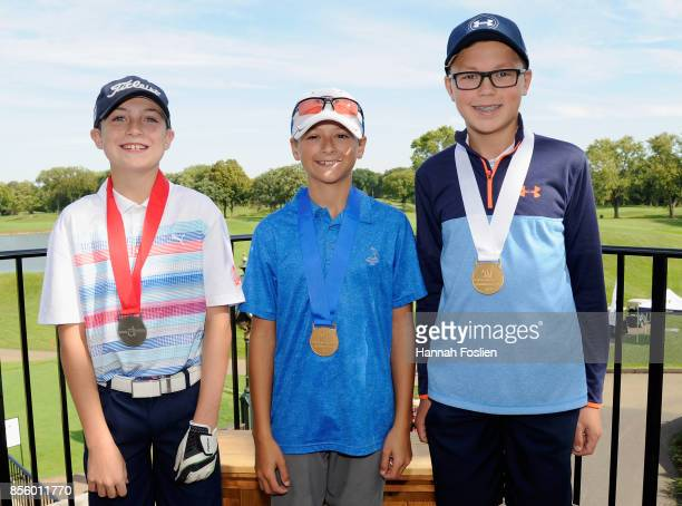 Second first and third place overall for the boys 1213 category Caeden Bolander Andrew Ramos and Carter Spalding pose for a photo at the regional...