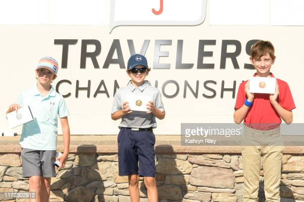 Second, first and third place overall for the boys 7-9 category Padraic Mulhern, Cole Roberts, and Julius Gill pose for a picture during the Drive,...