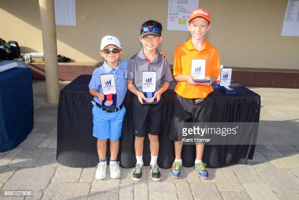 Second first and third place putting skills for boys age 79 category Jaden Rei Soong left Cole Kim center and Tate Nichols pose with their medals...