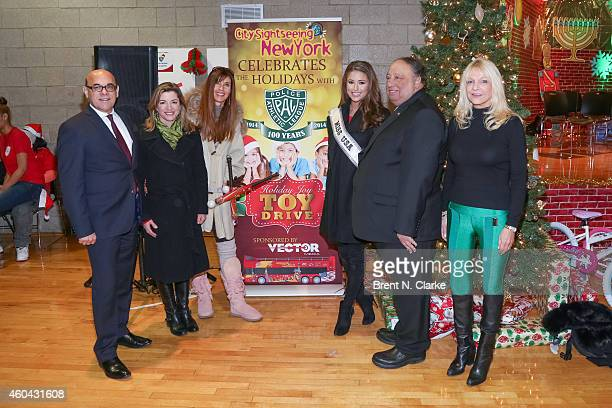 Second from left LR Actress Cynthia Gibb supermodel Carol Alt Miss USA 2014 Nia Sanchez PAL board members/holiday party chairs John and Margo...