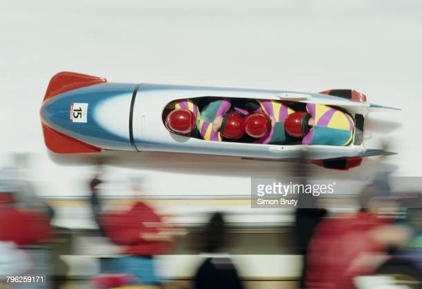 Second from the left Oleksandr Bortiuk finds himself facing the wrong way in the Unified Team four man bobsled team of Oleg Sukhoruchenko Oleksandr...