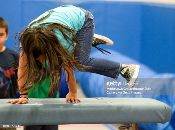Second grader Angela Arvizu jumps over a pommel horse in the American Ninja Warrior style obstacle course at Eagle Crest Elementary 4444 Clover Basin...