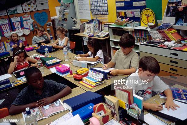 Second graders read in their Jerabek Elementary School classroom The school is a year round school | Location Scripps Ranch San Diego California USA