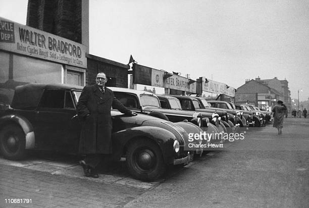 Second hand car dealer Walter Bradford on his lot in Birmingham February 1956 Original publication Picture Post The Car Men Reach The End Of Easy...