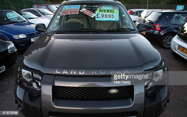A second hand car for sale is parked on a used car lot on July 4 2008 in Bristol England The value of second hand cars are expected to fall sharply...