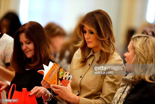 Second Lady Karen Pence and First Lady Melania Trump gather material during a Red Cross event to assemble comfort kits for troops deployed overseas...