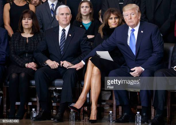 Second lady Karen Pence US Vice President Mike Pence first lady Melania Trump and President Donald Trump attend the cermonies as the late evangelist...