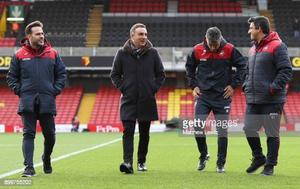 Second left Carlos Carvalhal Manager of Swansea City inspects the pitch with his assistants prior to the Premier League match between Watford and...