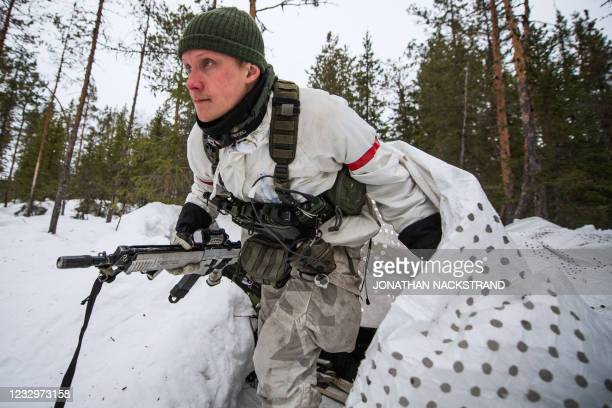 Second Lieutenant Oscar Sandstrom, a member of Swedens Ranger Battalions, gets out of a camouflaged tent in a forest north of Boden in northern...