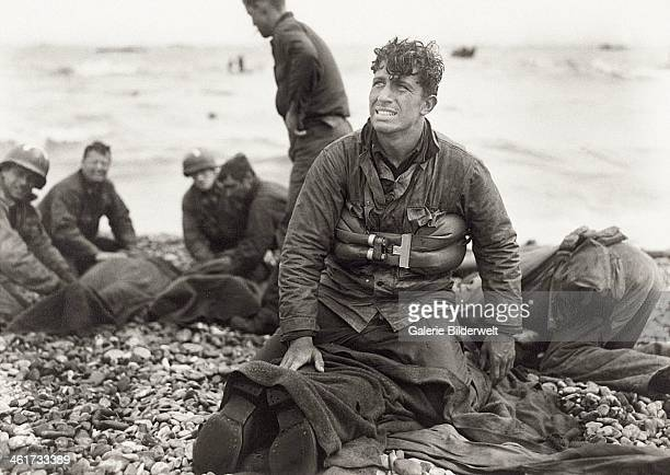Second Lieutenant Walter Sidlowski of 348th Engineer C Battalion 5th Engineer Special Brigade on Omaha Beach Normandy after helping to rescue a group...