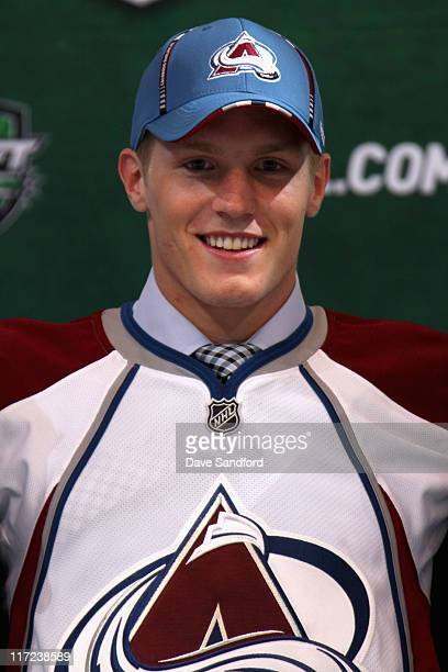Second overall pick Gabriel Landeskog by the Colorado Avalanche stands on the podium for a photo during day one of the 2011 NHL Entry Draft at Xcel...