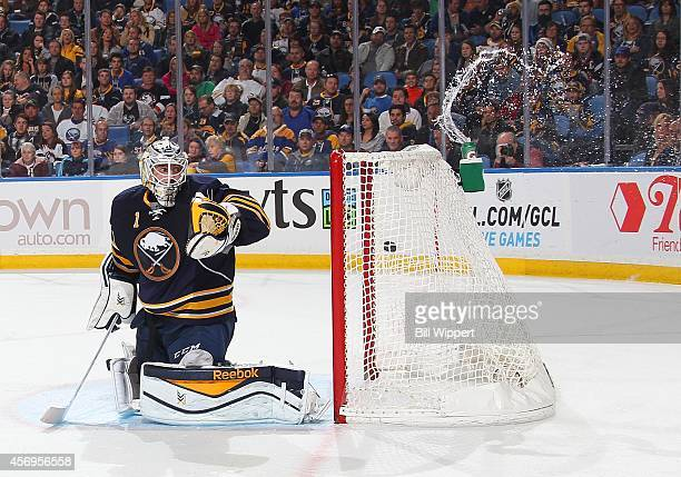 A second period goal by Jack Skille of the Columbus Blue Jackets sends water splashng from the bottle behind goaltender Jhonas Enroth of the Buffalo...