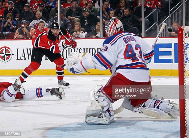 A second period shot by Ilya Kovalchuk of the New Jersey Devils goes past the glove of Martin Biron of the New York Rangers at the Prudential Center...