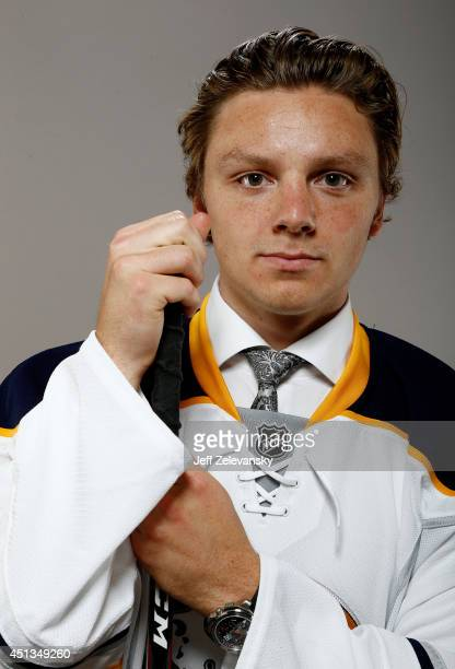 Second pick Sam Reinhart of the Buffalo Sabres poses for a portrait during the 2014 NHL Draft at the Wells Fargo Center on June 27 2014 in...