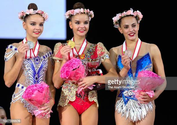 Second place Arina Averina of Gazprom and Russia winner Dina Averina of Gazprom and Russia and third place Linoy Ashram of Team Israel pose on the...