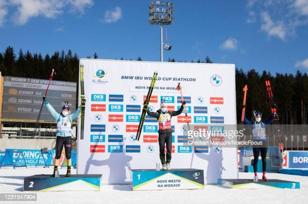 Second place athlete Yuliia Dzhima of Ukraine, race winner Tiril Eckhoff of Norway and third place athlete Lisa Vittozzi of Italy celebrate during...