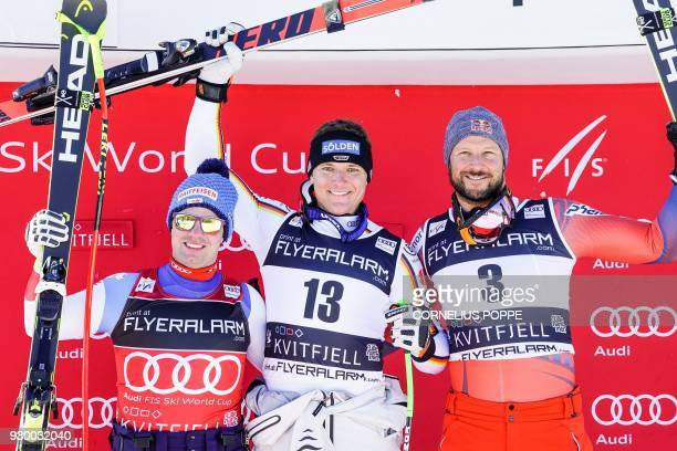 Second place Beat Feuz from Switzerland German Thomas Dressen and third placed Norwegian Aksel Lund Svindal celebrate after the FIS Ski World Cup...