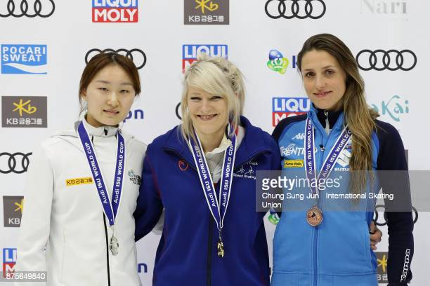 Second place Choi MinJeong of South Korea first place Elise Christie of Great Britain and third place Martina Valcepina of Italy celebrate during the...