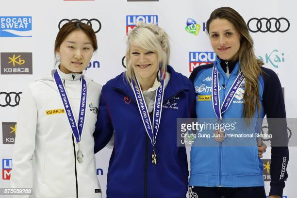Second place Choi MinJeong of South Korea first place Elise Christie of Great Britain and third place Martina Valcepina of Italy celebrate on the...