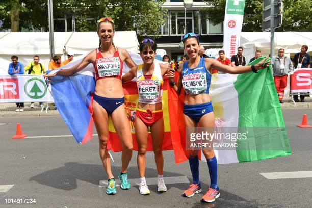 Second place Czech Republic's Anezka Drahotova winner Spain's Maria Perez and third place Italy's Antonella Palmisano pose for photographers with...