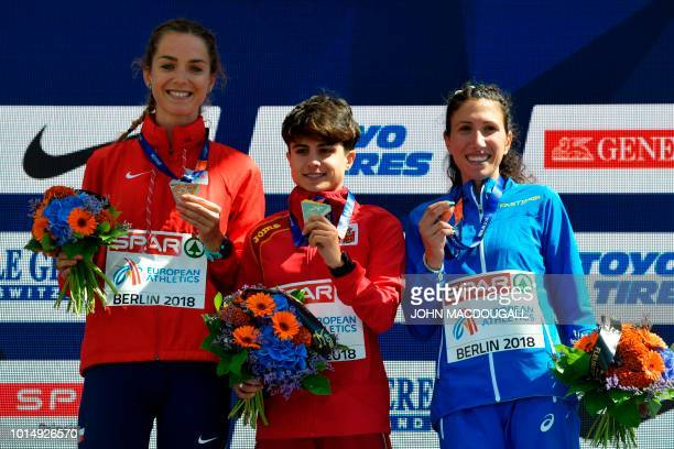 Second place Czech Republic's Anezka Drahotova winner Spain's Maria Perez and third place Italy's Antonella Palmisano pose for photographers on the...