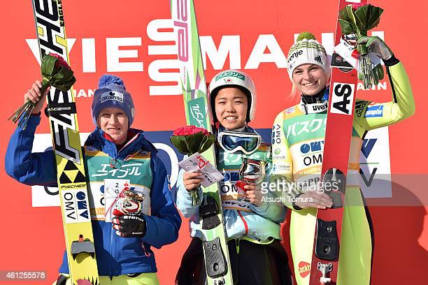 Second place Daniela Iraschko-Stolz of Austria, first place Sara Takanashi of Japan and third place Spela Rogelj of Slovenia pose in the victory...