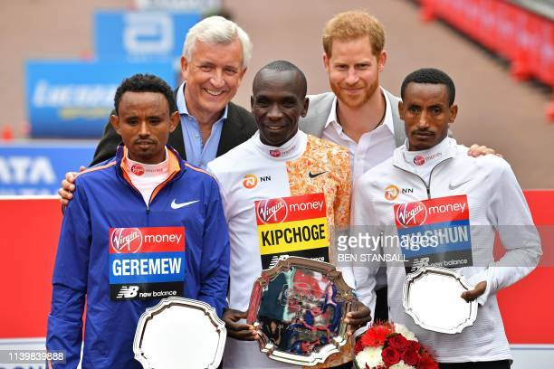 Second place Ethiopia's Mosinet Geremew winner Kenya's Eliud Kipchoge and third place Ethiopia's Mule Wasihun pose for a photograph with Britain's...