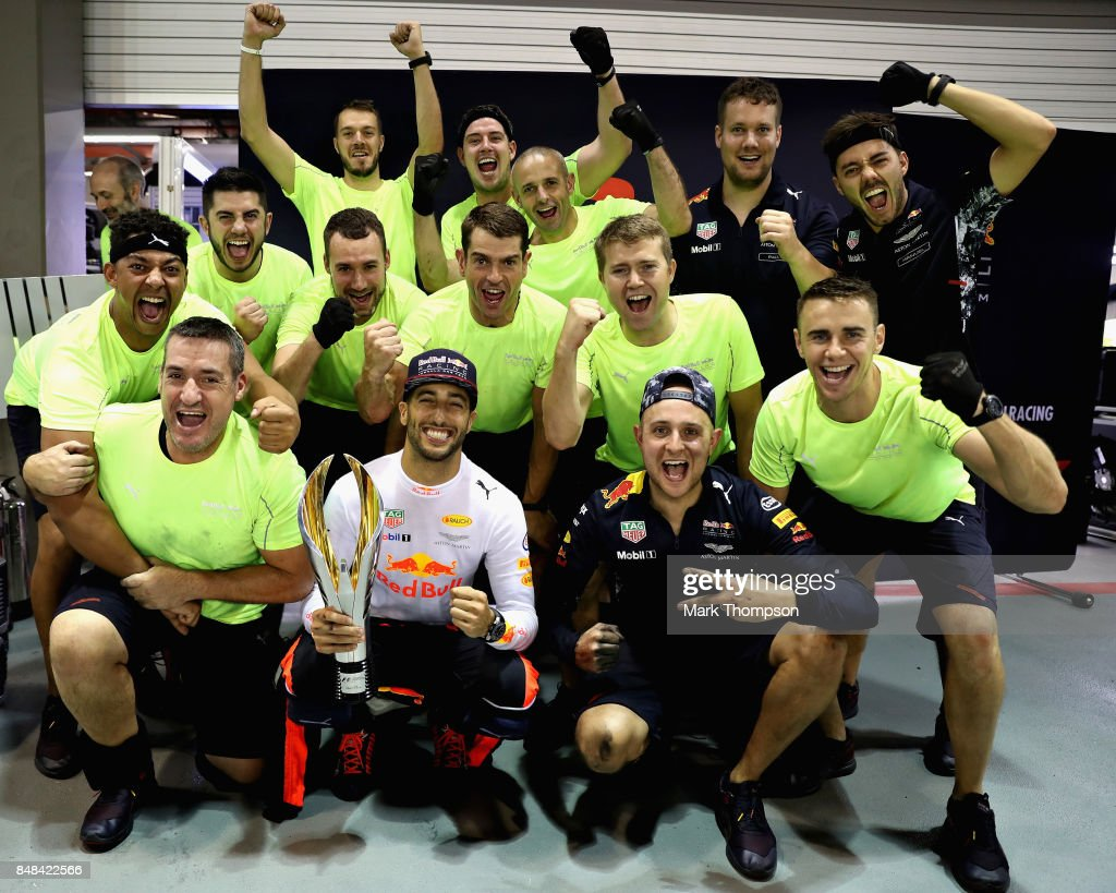 Second place finisher Daniel Ricciardo of Australia and Red Bull Racing celebrates with his team during the Formula One Grand Prix of Singapore at Marina Bay Street Circuit on September 17, 2017 in Singapore.