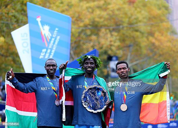 Second place finisher Geoffrey Kamworor of Kenya first place finisher Stanley Biwott of Kenya and third place finisher Lelisa Desisa of Ethiopia pose...