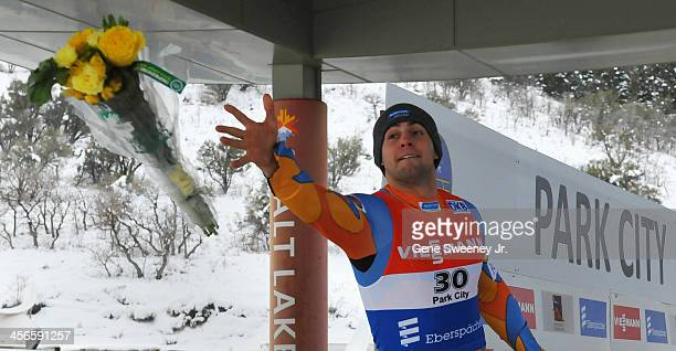 Second place finisher in the Men's Luge competition Chris Mazdzer of the United States tosses his flowers to the crowd during day 2 of the Viessmann...