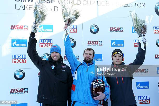 Second place finisher Matthew Antoine of the United States first place winner Alexander Tretiakov of Russia and third place finisher Sungbin Yun of...