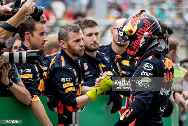 Second place finisher Max Verstappen of Netherlands and Red Bull Racing shakes hands with his team in parc ferme during the Formula One Grand Prix of...