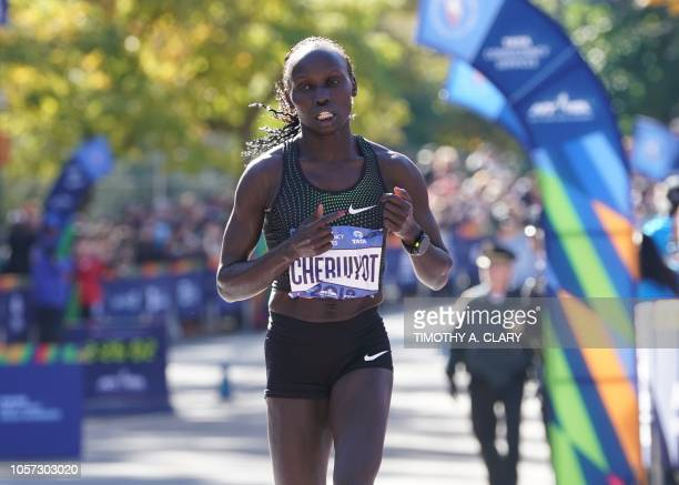 Second place finisher Vivian Cheruiyot of Kenya crosses the finish line during the Women's Division during the 2018 TCS New York City Marathon in New...