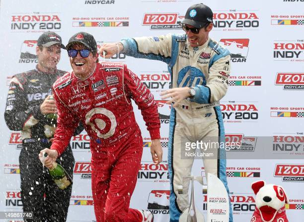 Second place finisher Will Power of Australia driver of the Verizon Team Penske Chevrolet winner Scott Dixon of New Zealand driver of the Target Chip...