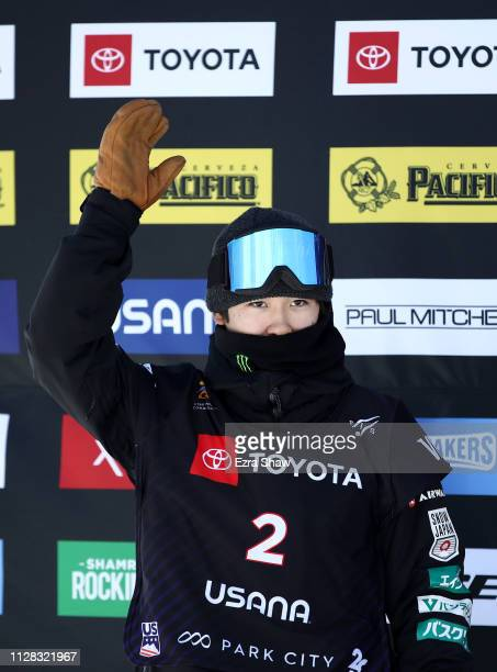 Second place finisher Yuto Totsuka of Japan waves to the crowd on the podium after the Men's Snowboard Halfpipe Finals at the FIS Snowboard World...