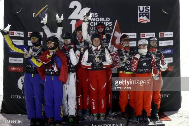 Second place finishers Jiaxu Sun Mengtao Xu and Xindi Wang of China gold medal winners Noe Roth Carol Bouvard and Nicolas Gygax of Switzerland and...