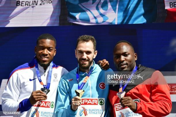 Second place Great Britain's Nethaneel MitchellBlake winner Turkey's Ramil Guliyev and third place Switzerland's Alex Wilson pose on the podium...