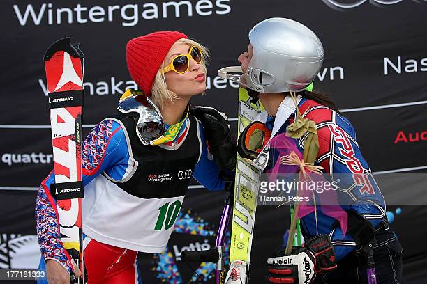 Second place Heather Mills of Great Britain kisses first place winner Melanie Schwartzc of the USA after competing in the Womens Slalom Standing race...