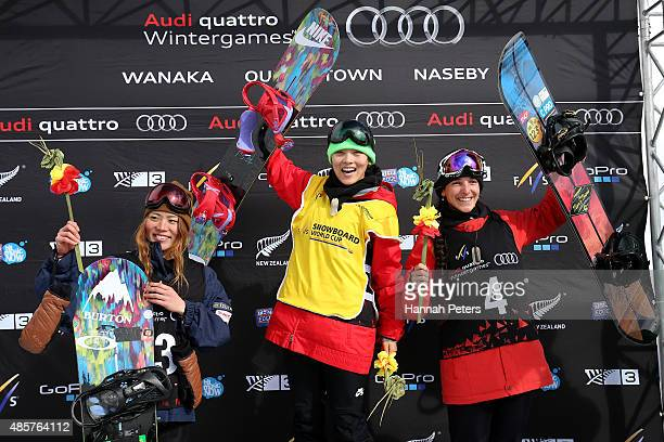Second place Hikaru Oe of Japan first place Xuetong Cai of China and third place Sophie Rodriguez of France pose on the podium for the flower...