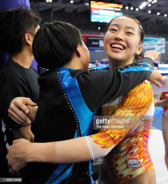 Second place Hitomi Hatakeda is congratulated by Mai Murakami on day one of the Artistic Gymnastics NHK Trophy at Musashino Forest Sport Plaza on May...