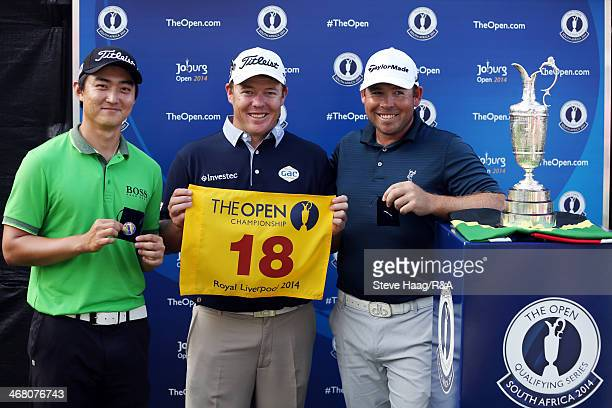 Second place Jin Jeong of South Korea winner of the Joburg Open George Coetzee of South Africa and also second place Justin Walters of South Africa...