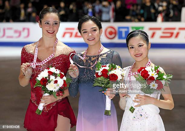 Second place Kaetlyn Osmond of Canada first place Evgenia Medvedeva of Russia and third place Satoko Miyahara of Japan pose on the podium at the...