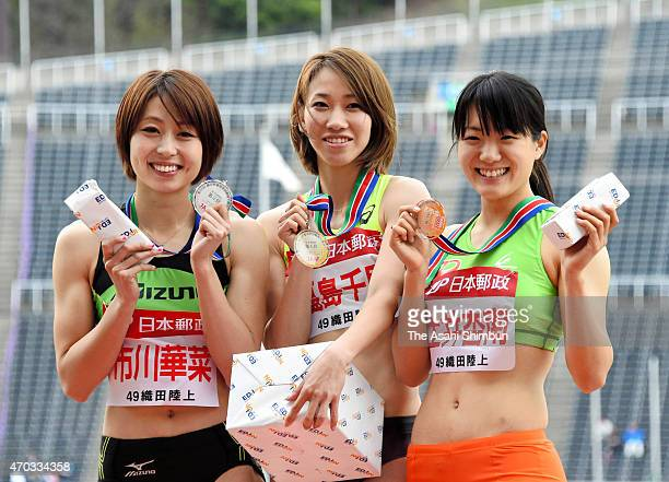 second place Kana Ichikawa winner Chisato Fukushima and third place Anna Doi pose for photographs after the award ceremony for the Women's 200m...