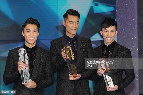 Second place Karl Ting fist place Jackson Lai and third place Freeyon Chung pose after the Mr Hong Kong Pageant 2016 at TVB City on September 11 2016...