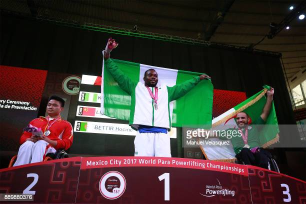 Second Place Lei Liu of China First Place Paul Kehinde of Nigeria and Hocine Bettir of Algeria celebrates with their medals during the Men's Up to...