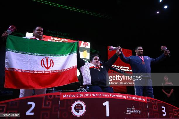Second Place Mansour Pourmirzaei of Iran Fist Place Siamand Rahman of Iran and Third Place Jamil Elshebli of Jordan celebrates with their medals...