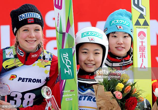 Second place Maren Lundby of Norway first place Sara Takanashi of Japan and third place Yuki Ito of Japan celebrate on the podium the FIS Women's Ski...