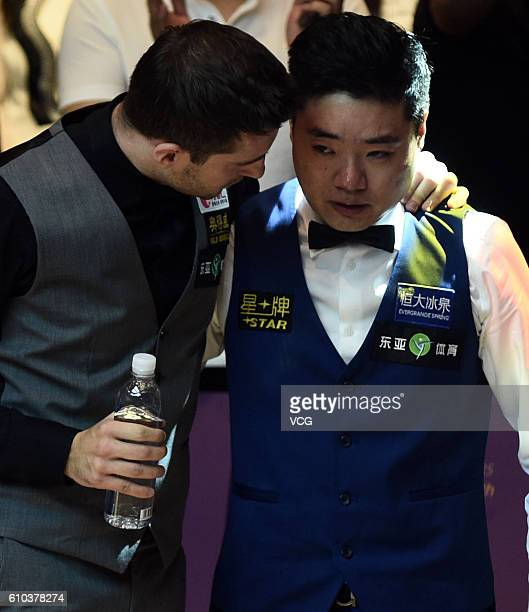 Second place Mark Selby of England speaks to winner Ding Junhui of China after the final match against on day seven of the Shanghai Masters 2016 at...