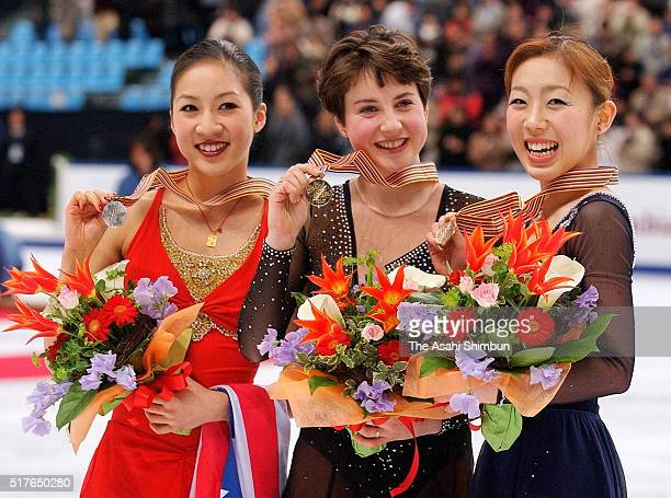 Second place Michelle Kwan of the United States winner Irina Slutskaya of Russia and third place Fumie Suguri of Japan pose on the podium at the...