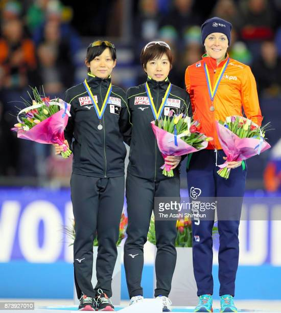 Second place Miho Takagi of Japan first place Nao Kodaira of Japan and third place Jorien ter Mors of the Netherlands pose on the podium at the medal...